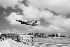 Philipsburg, Sint Maarten - February 13, 2016: plane low fly over maho beach. Jet flight land on cloudy blue sky. Philipsburg, Sint Maarten - February 13, 2016 stock image