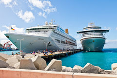 Philipsburg, St. Maarten. Jan. 16, 2013: Cruise ships docked at Dr. A. C. Wathey Pier on the Dutch side of St. Maarten.  Passengers wanting to go to town are Royalty Free Stock Photos