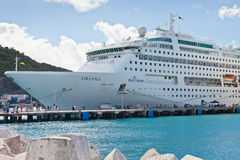 Philipsburg, St. Maarten. Jan. 16, 2013: Cruise ships docked at Dr. A. C. Wathey Pier on the Dutch side of St. Maarten.  Passengers wanting to go to town are Royalty Free Stock Photography