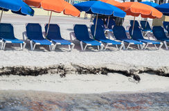 Philipsburg St. Maarten beach with umbrellas. Philipsburg St. Maarten small beach area with chairs for relaxing in the shade of blue and orange umbrellas Stock Images