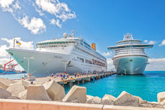 Philipsburg, St. Maarten. Jan. 16, 2013: Cruise ships docked at Dr. A. C. Wathey Pier on the Dutch side of St. Maarten.  Passengers wanting to go to town are Royalty Free Stock Images