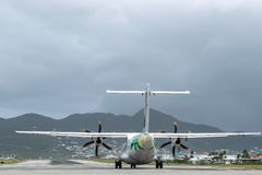 Air Antilles medium twin turbo-prop regional aircraft ATR 42-500 on runway royalty free stock photo