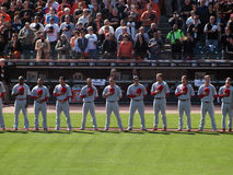 Phillies Players stand in a line with hats removed Stock Photo