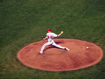 Phillies reliever Ryan Madson steos firward to throws hard from Stock Photography