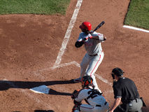 Phillies Ryan Howard holds bat on shoulder in the batters box during as he waits for pitch with Buster Posey. SAN FRANCISCO, CA - OCTOBER 20: Giants vs. Phillies Stock Photography