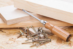 Phillips head screwdriver and wood screws Royalty Free Stock Photography