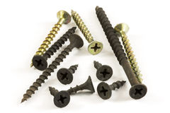 Phillips Screws. A few drywall Phillips screws with a bugle head isolated over white background Royalty Free Stock Photo