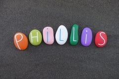 Phillis, nome dado comemorou com uma multi composição colorida das pedras sobre a areia vulcânica preta foto de stock royalty free