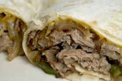 Philly cheese steak. Wrap sandwich with onions peppers Stock Photography