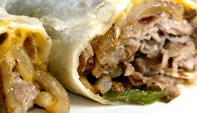 Philly cheese steak. Wrap sandwich with onions peppers Stock Images