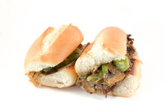 Philly Cheese Steak. Messy philly cheese steak with mushrooms onions and peppers Royalty Free Stock Photos