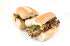 Philly Cheese Steak. Messy philly cheese steak with mushrooms, onions, and peppers Stock Photography