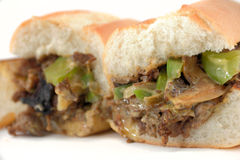 Philly Cheese Steak. Messy Philly cheese steak with mushrooms onions and peppers Royalty Free Stock Photography