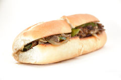 Philly Cheese Steak. Messy Philly cheese steak with mushrooms onions and peppers Stock Images