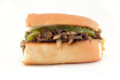 Philly Cheese Steak. Messy Philly cheese steak with mushrooms and peppers and onions Stock Photos