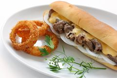 Philly cheese steak sandwich. With onion rings Stock Photo