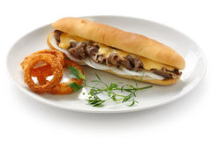 Philly cheese steak sandwich. With onion rings Stock Photos