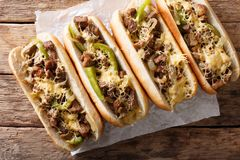 Philly cheese steak sandwich served on parchment paper close-up. horizontal top view. Philly cheese steak sandwich served on parchment paper close-up on the royalty free stock image