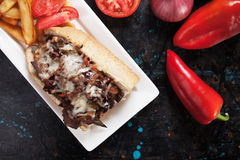 Philly cheese steak sandwich. With tomato and french fries Stock Photos