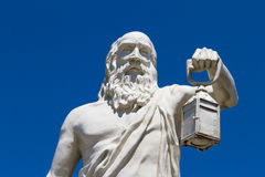 Philosopher Diogenes. Holding light sculpture on blue sky, Sinop, Turkey royalty free stock image