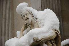 Philosopher Herodotus covered by snow. Statue of philosopher Herodotus covered by snow in front of Austria Parliament, Vienna royalty free stock image