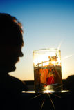 Philosophical question To drink or not to drink. A man against the glass of vodka.  A glass is with picture of drunk cossack Royalty Free Stock Photos