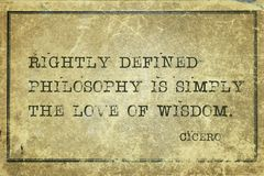 Philosophy is Cicero. Rightly defined philosophy is simply the love of wisdom - ancient Roman philosopher Cicero quote printed on grunge vintage cardboard stock image