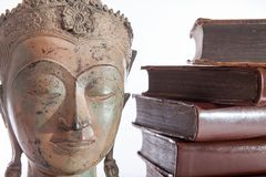 Philosophy and ethics. The philosopher Buddha statue and ancient. Religious education books representing wisdom and philosophical teaching royalty free stock images