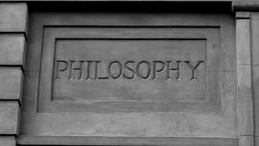 `Philosophy` In Roman Style Stone Carving. Stone marble imitation carving, showing the word `Philosophy royalty free stock images