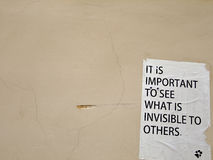 Philosophy on the Wall. Note saying that it is important to see what is invisible to others on the Wall of old Building Royalty Free Stock Image
