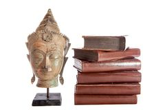 Philosophy and wisdom. The philosopher Buddha with ancient theology text books. stock photo