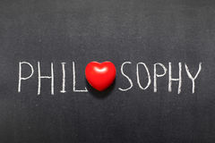 Philosophy. Word handwritten on chalkboard with heart symbol instead of O royalty free stock photos
