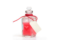 Philtre. Glass bottle with love potion Stock Photos