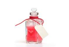 philtre Szklana butelka z miłość napojem miłosnym Zdjęcia Stock