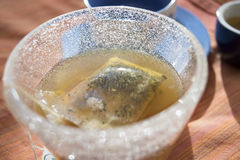 Philtre of tisane in infusion in hot water. Philtre of depurative tisane in infusion in hot water Stock Photography