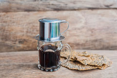`Phin` traditional Vietnamese coffee maker, place on the top of glass, add ground coffee then pour hot water and wait until the co Royalty Free Stock Image