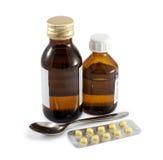 Phiole mit Droge und Scheibe der Tablette Lizenzfreie Stockbilder