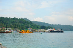 PhiPhi Don Island Dive Boats. Dive and tourist boats docked at PhiPhi Don Island on the Andaman Sea in Thailand Stock Photo