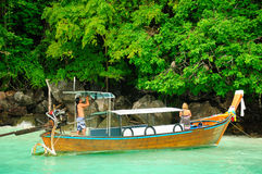 PhiPhi Island Boat Thailand. A wooden boat moored near the wild monkey island near the Phi Phi Islands on the Andaman Sea in Thailand Stock Images