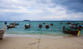 PhiPhi island long tail boats. Long tail boats stop at the Thailand PhiPhi island beach Royalty Free Stock Photo