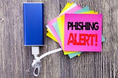 Phishing Alert. Business concept for Fraud Warning Danger written on sticky note with copy space on old wood wooden background wit. Phishing Alert. Business Stock Photos