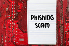 Phishing scam text concept. Red old dirty computer circuit board and text concept Royalty Free Stock Images