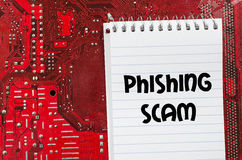 Phishing scam text concept. Red old dirty computer circuit board and text concept Stock Images