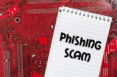 Phishing scam text concept. Red old dirty computer circuit board and text concept Stock Photo