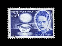 Phisicist Marie Sklodowska-Curie 1867-1934, bowl glowing with radium, circa 1967,. FRANCE - CIRCA 1967: canceled stamp printed in France shows famous polish Royalty Free Stock Photography