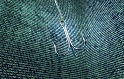 Phising digital safety concept fishing hook in digital enviromen Royalty Free Stock Photos