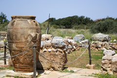 Phitos in minoan Palace of Malia - Crete. Pithos is the ancient Greek word for a large storage jar of a characteristic shape - Grece Stock Image
