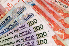 Phlippine Banknotes. Philippine Currency of various values spread on a flat surface royalty free stock photos