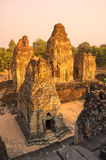 Phnom Bakheng temple at sunset. Phnom Bakheng at Angkor, Cambodia, is a Hindu and Buddhist temple in the form of a temple mountain, dedicated to Shiva Royalty Free Stock Photo