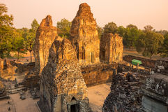 Phnom Bakheng temple at sunset. Phnom Bakheng at Angkor, Cambodia, is a Hindu and Buddhist temple in the form of a temple mountain, dedicated to Shiva Royalty Free Stock Image